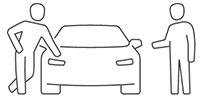 2 Personen beim Verhandeln über Gebrauchtwagen